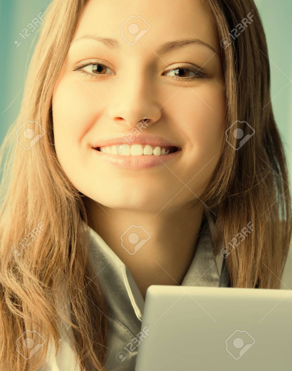 Portrait of cheerful female doctor working with laptop at office Stock Photo - 29750464