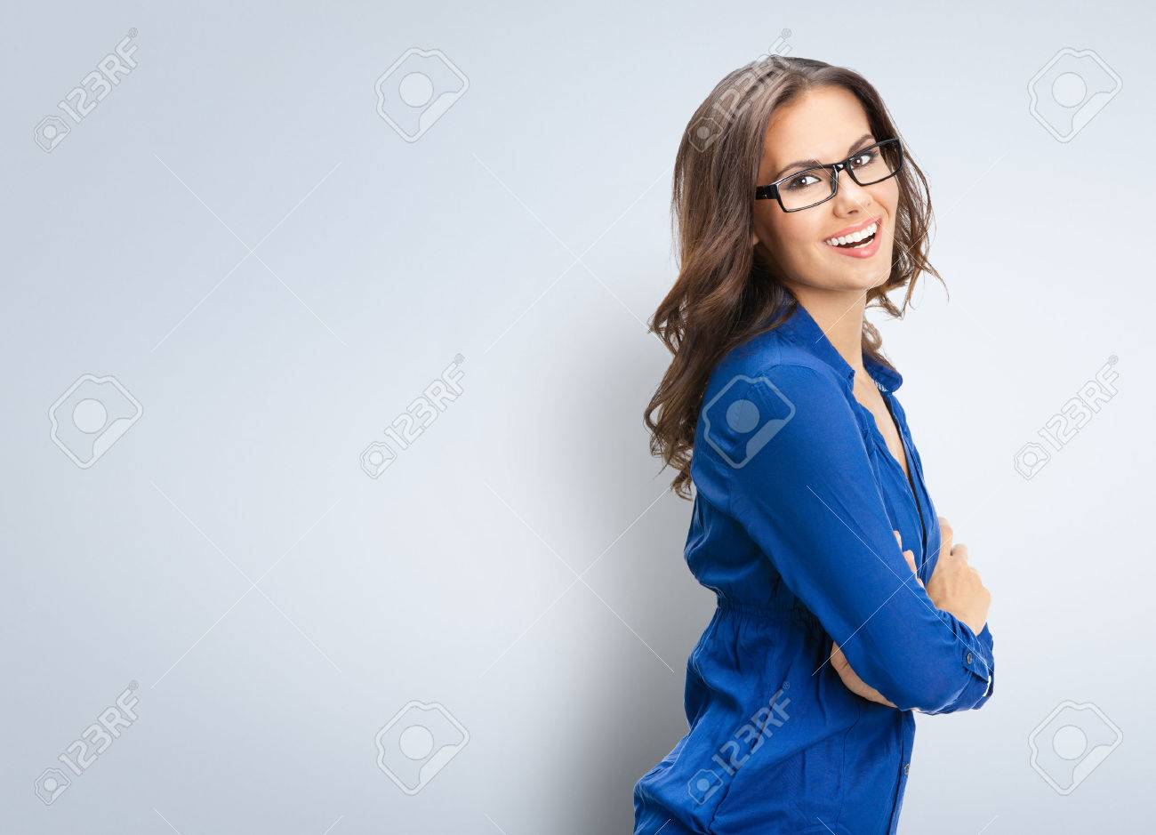 Portrait of smiling young businesswoman in glasses, with blank copyspace area for slogan or text - 40543353