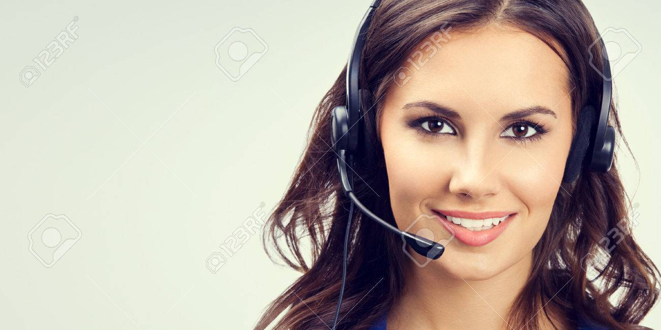 Portrait of cheerful young support phone operator or businesswomen in headset, with blank copyspace area for slogan or text. Customer service concept. - 41223485