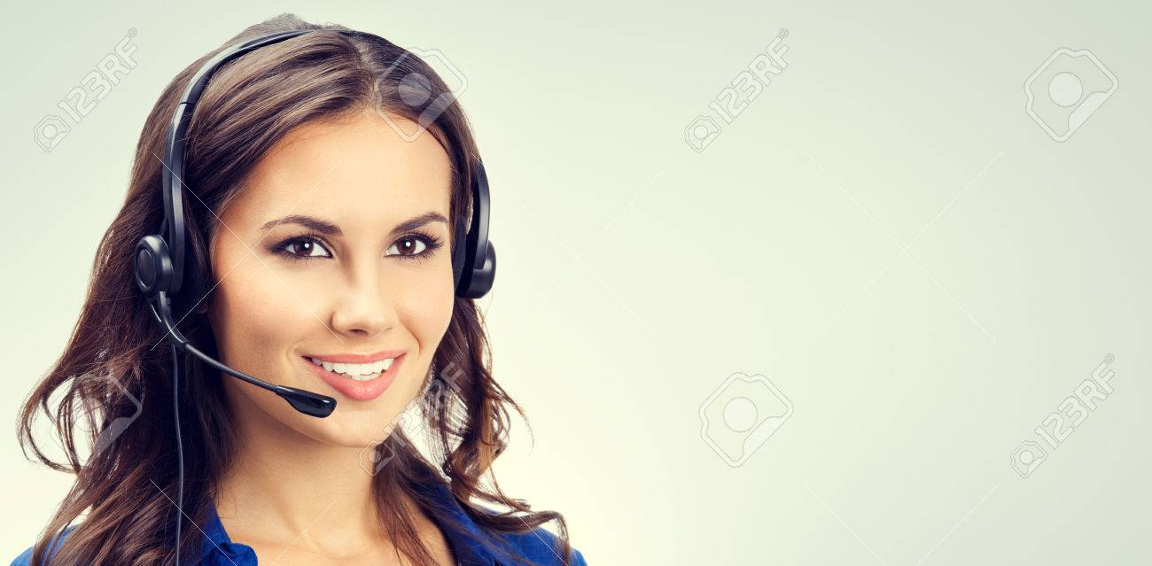 Cheerful smiling young support phone operator or businesswomen in headset, with blank copyspace area for slogan or text. Customer service concept. - 41223487