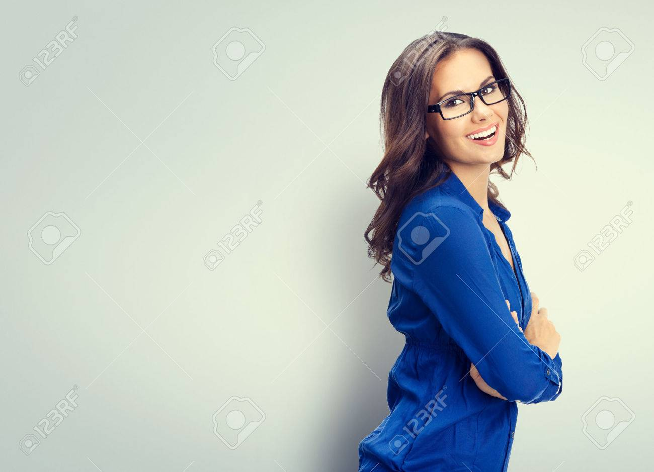 Cheerful smiling young businesswoman in glasses, with blank copyspace area for slogan or text Banque d'images - 41223488