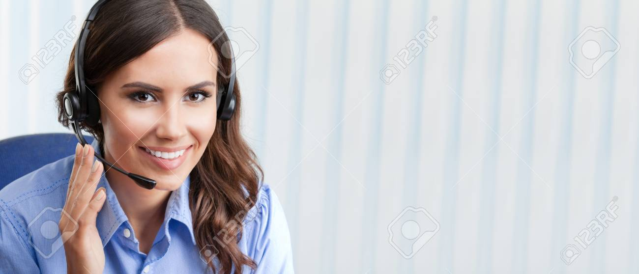 Portrait of happy smiling cheerful beautiful young female support phone operator in headset, at office, with blank copyspace area for slogan or text. Customer assistance service concept. Banque d'images - 41556470