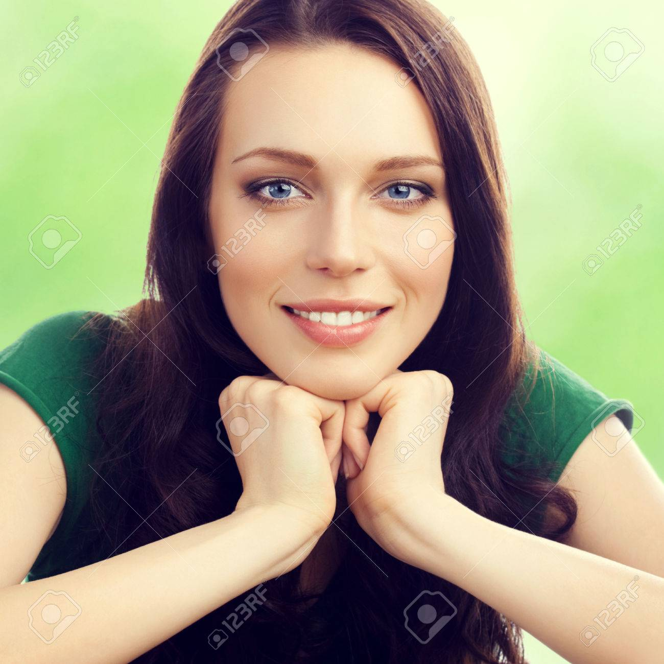 Portrait of cheerful smiling beautiful young brunette woman, outdoor - 42478365