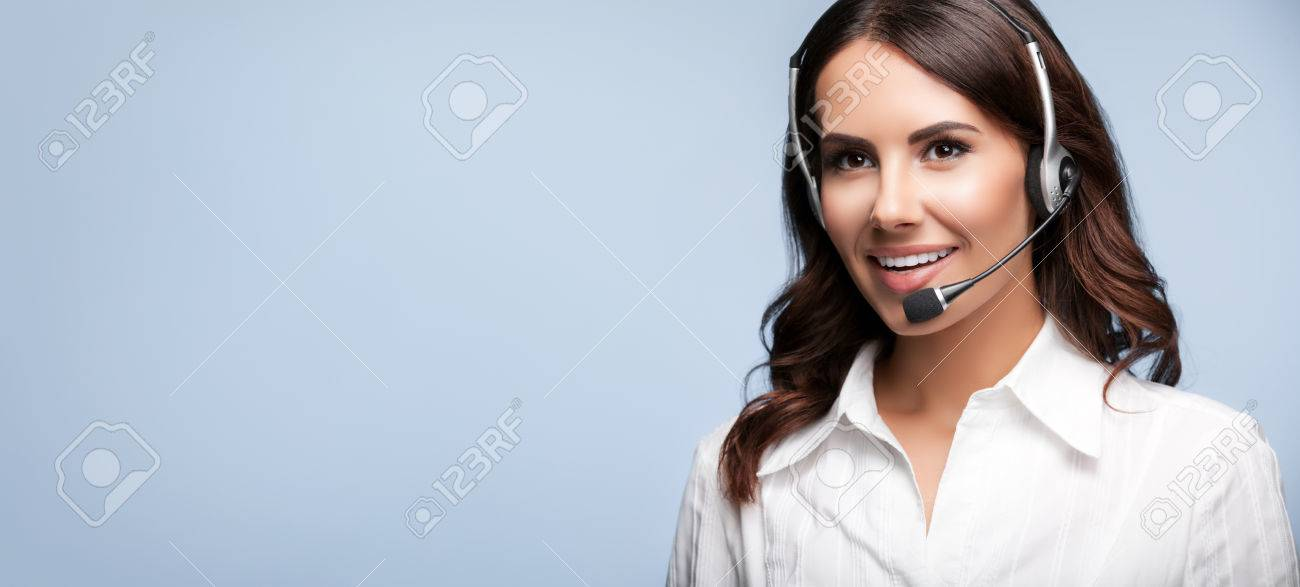 smiling customer support female phone operator in headset, against grey background. Consulting and assistance service call center. - 42486274