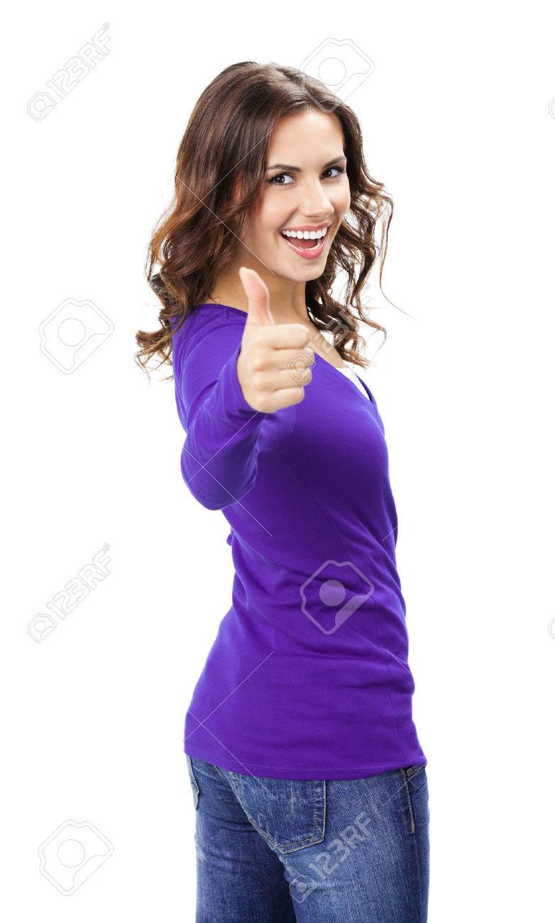 Happy smiling beautiful young woman showing thumbs up gesture, in violet casual clothing, isolated over white background - 44946251