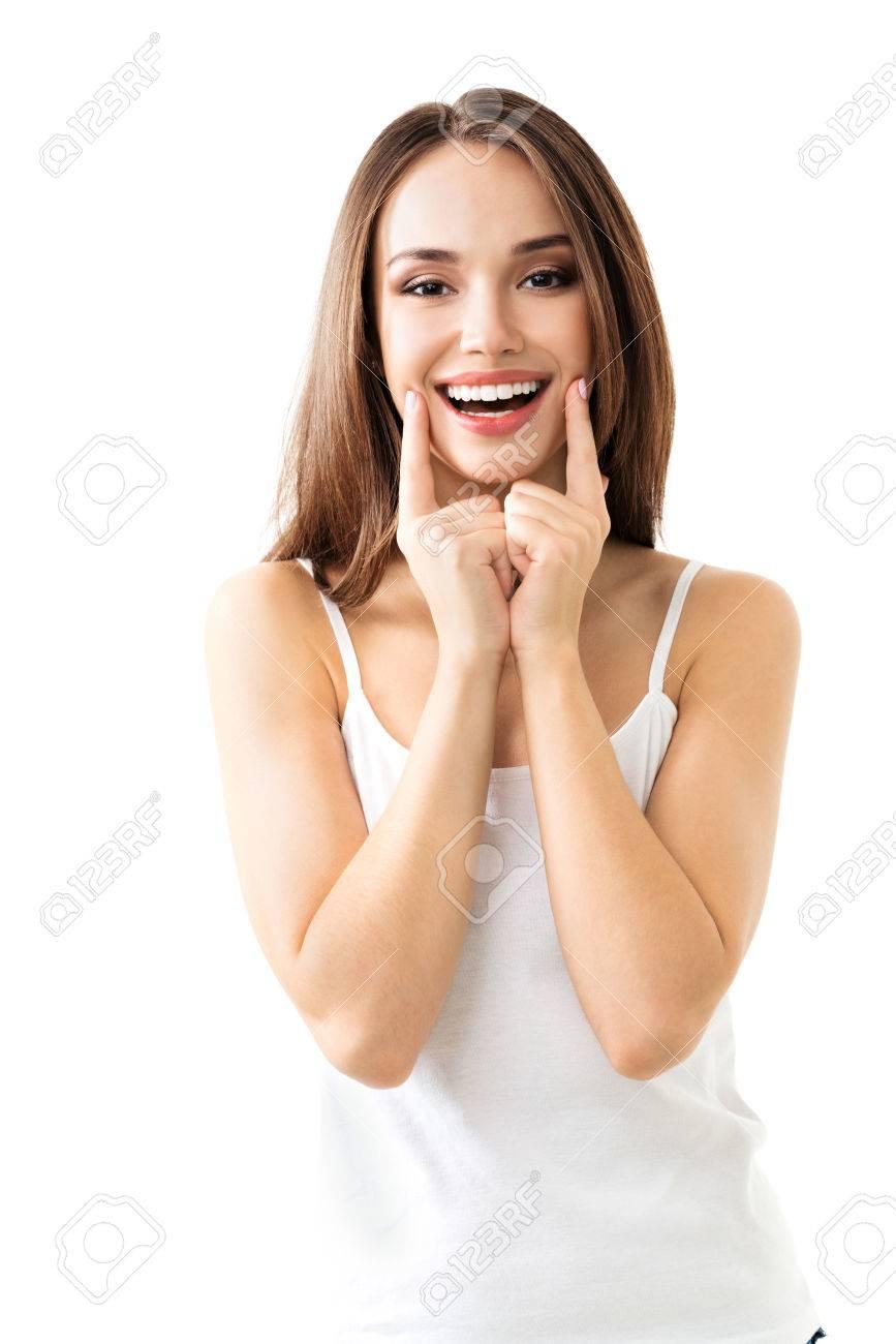 jeune femme montrant sourire, dans les vêtements chic et décontracté, isolé sur fond blanc Banque d'images - 48289318
