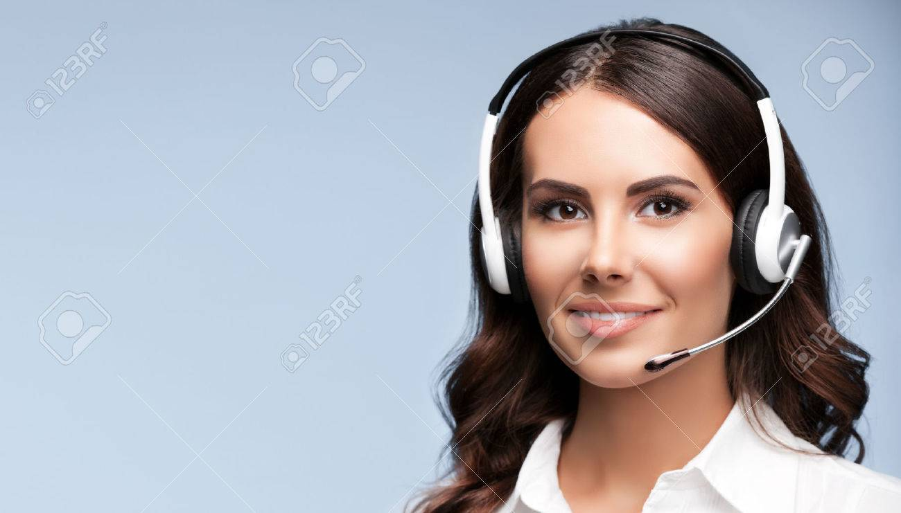 Female customer support phone operator in headset, against grey background, with copyspace area for slogan or text message - 50079033
