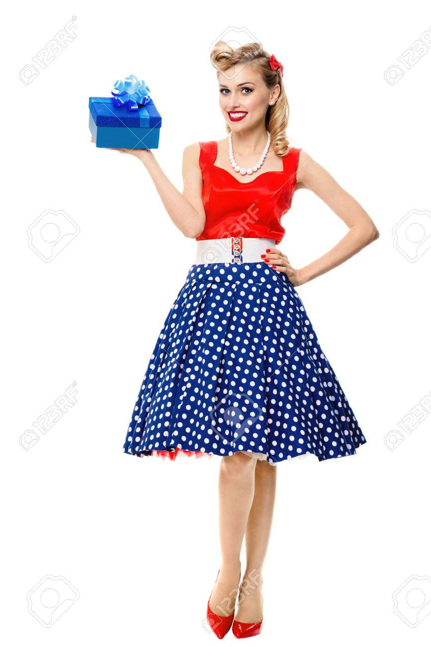 Full body portrait of beautiful young happy smiling woman dressed in pin-up style dress with polka dot, isolated over white background. Caucasian blond model posing in retro fashion and vintage concept studio shoot. - 51372634