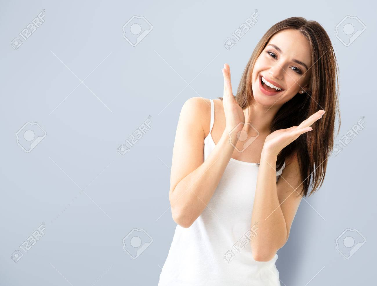young woman showing smile, in casual smart clothing, with copyspace area for text or slogan - 59131375