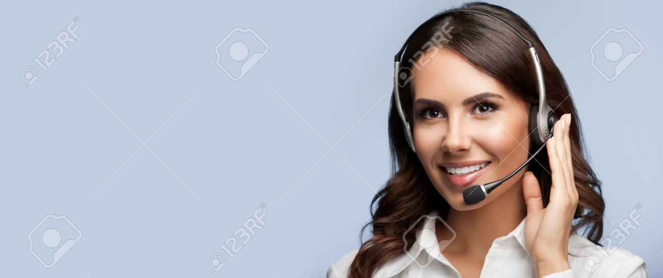 Portrait of support female phone operator in headset, with blank copyspace area for slogan or text message, on grey background. Consulting and assistance service call center. - 61283750