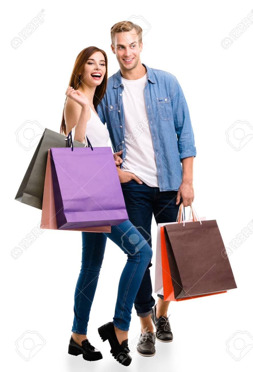 d20c365e62e Happy couple with shopping bags, standing close to each other with smile.  Caucasian models