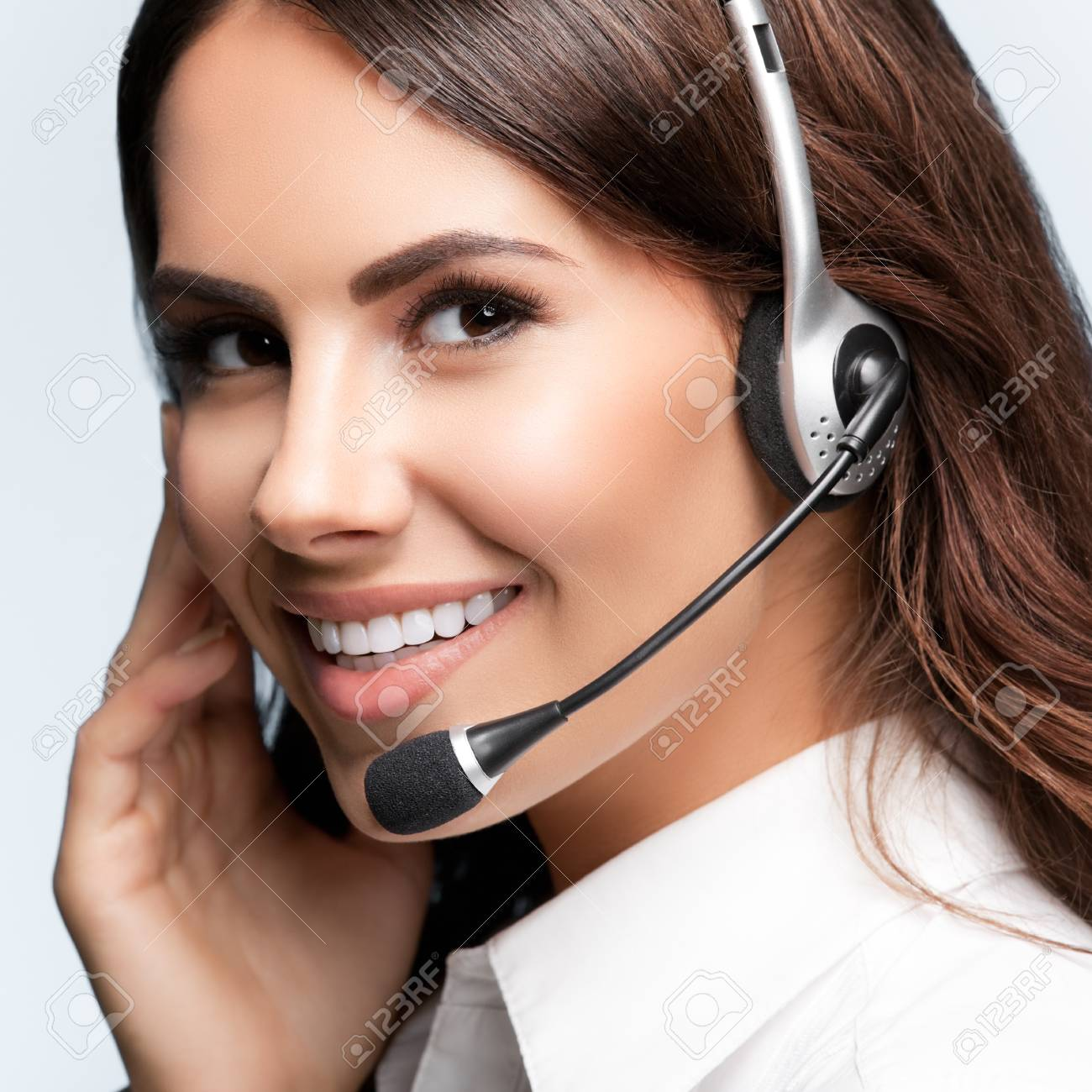 customer support phone operator in headset, against grey background. Consulting and assistance service call center. - 75498499