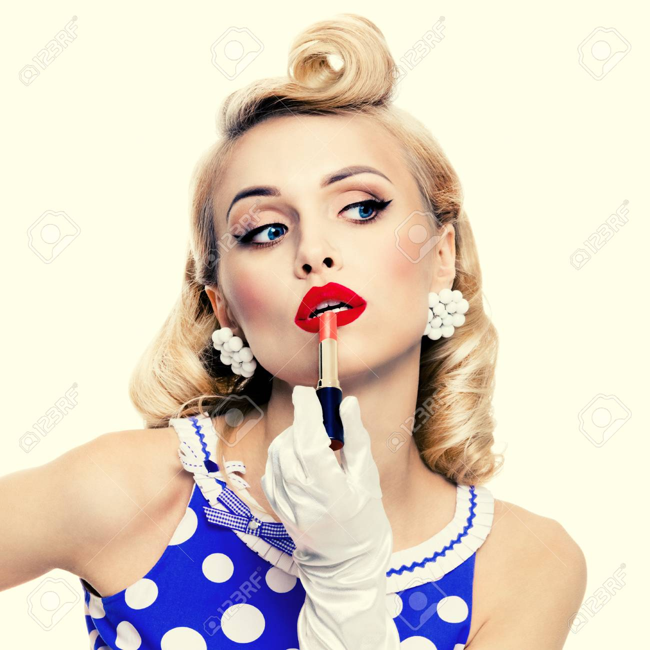 07d2d5d5e Stock Photo - Young blond woman in pin-up style blue dress in polka dot