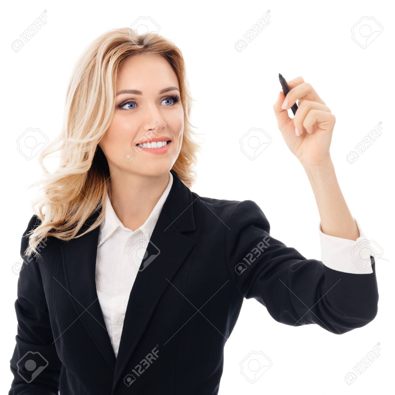 Happy smiling cheerful young businesswoman writing or drawing something on screen or transparent glass, by blue marker, isolated over white background - 120343373