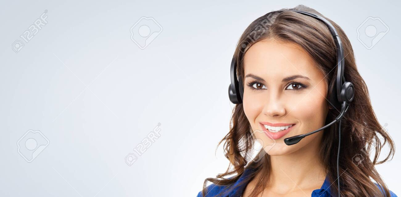 Portrait of happy smiling young support phone operator, sales phone agent or businesswomen in headset, with blank copy space area for slogan or text - 135552134