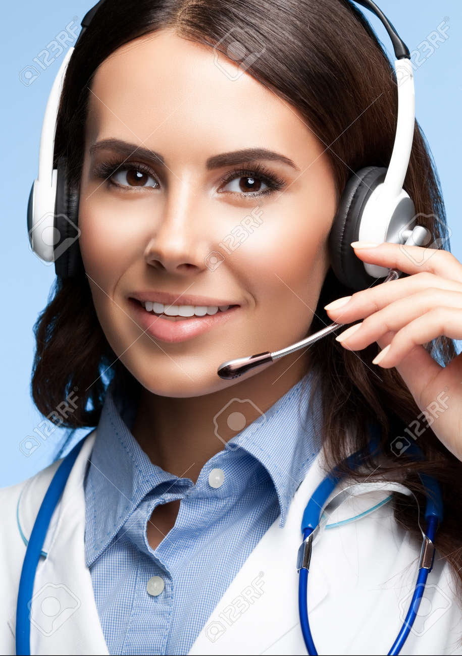 Portrait of happy smiling young doctor in headset, on bright blue background. Medical call center - healthcare concept picture. - 145241541