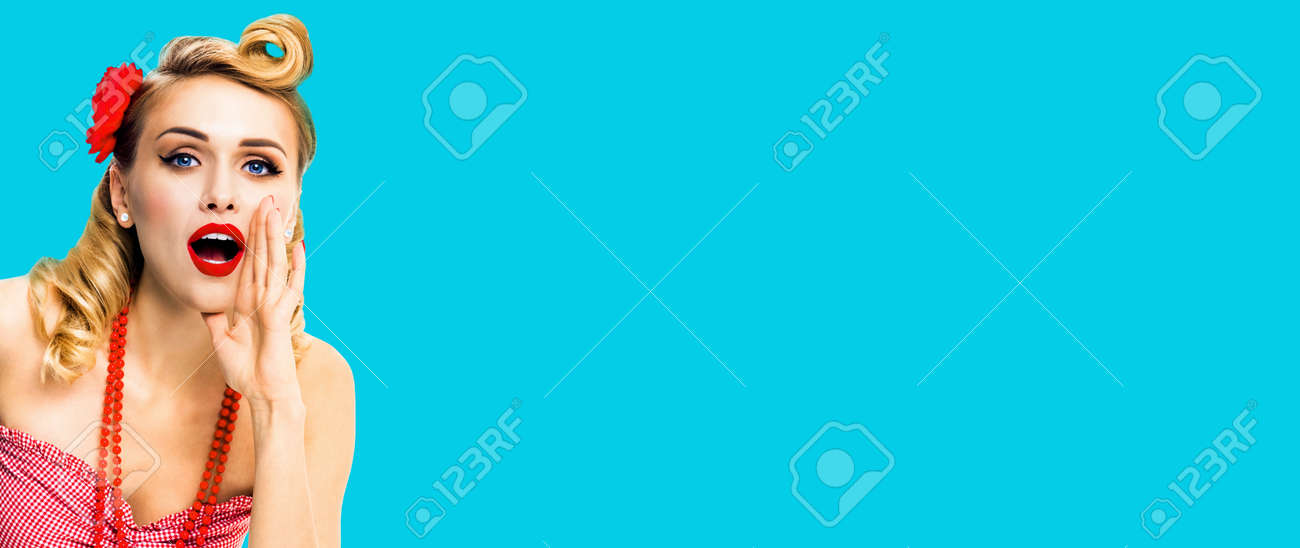 Image of woman holding hand near open mouth and saying something. Girl dressed in pin up style. Blond haired model at retro fashion vintage concept, isolated over blue green. - 171533262