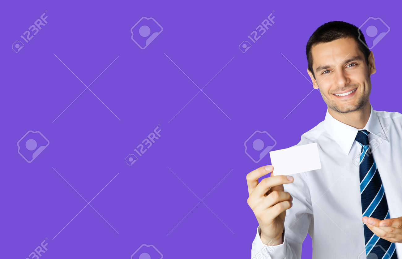 Happy smiling businessman in white shirt and tie, showing blank business or plastic credit card, copy space area for text or sign, violet purple colour background. Confident business man at studio. - 171778904