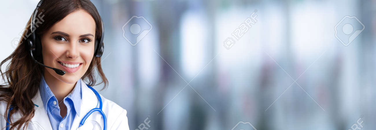 Portrait of happy smiling female doctor in headset, over blurred modern office background, copy space area for some text. Medical help call center concept. - 171710496