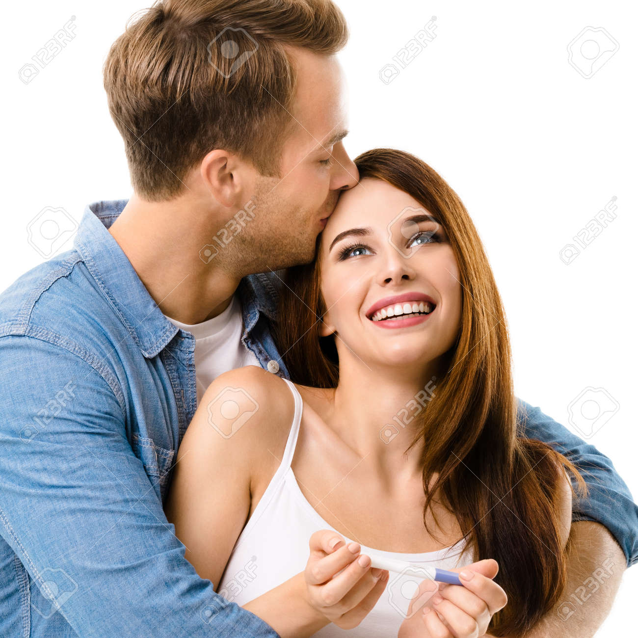 Young couple, finding out results of a pregnancy test. Caucasian models - in love, relationship, dating, happy lovers, family concept, cut out on white background. Square. - 172034744
