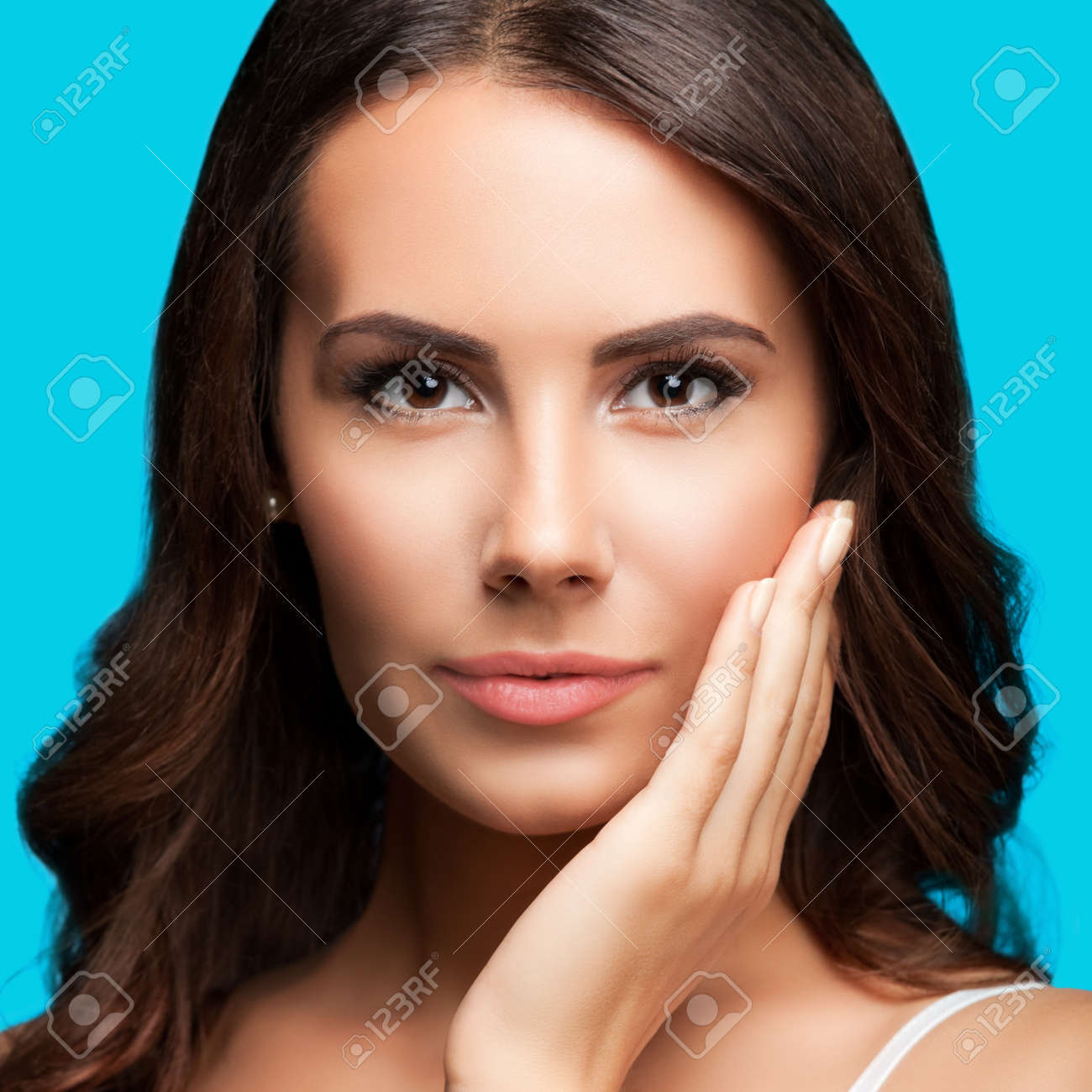 Portrait of beautiful woman in white casual tank top, over aqua blue green background. Brunette lovely girl at studio fashion concept. Square composition image. - 171953424