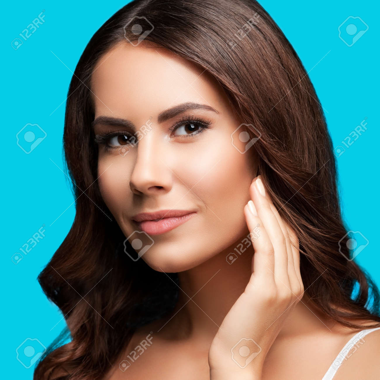 Portrait of beautiful woman in white casual tank top, over aqua blue green background. Brunette girl at studio beauty concept. Square composition image. - 171953008