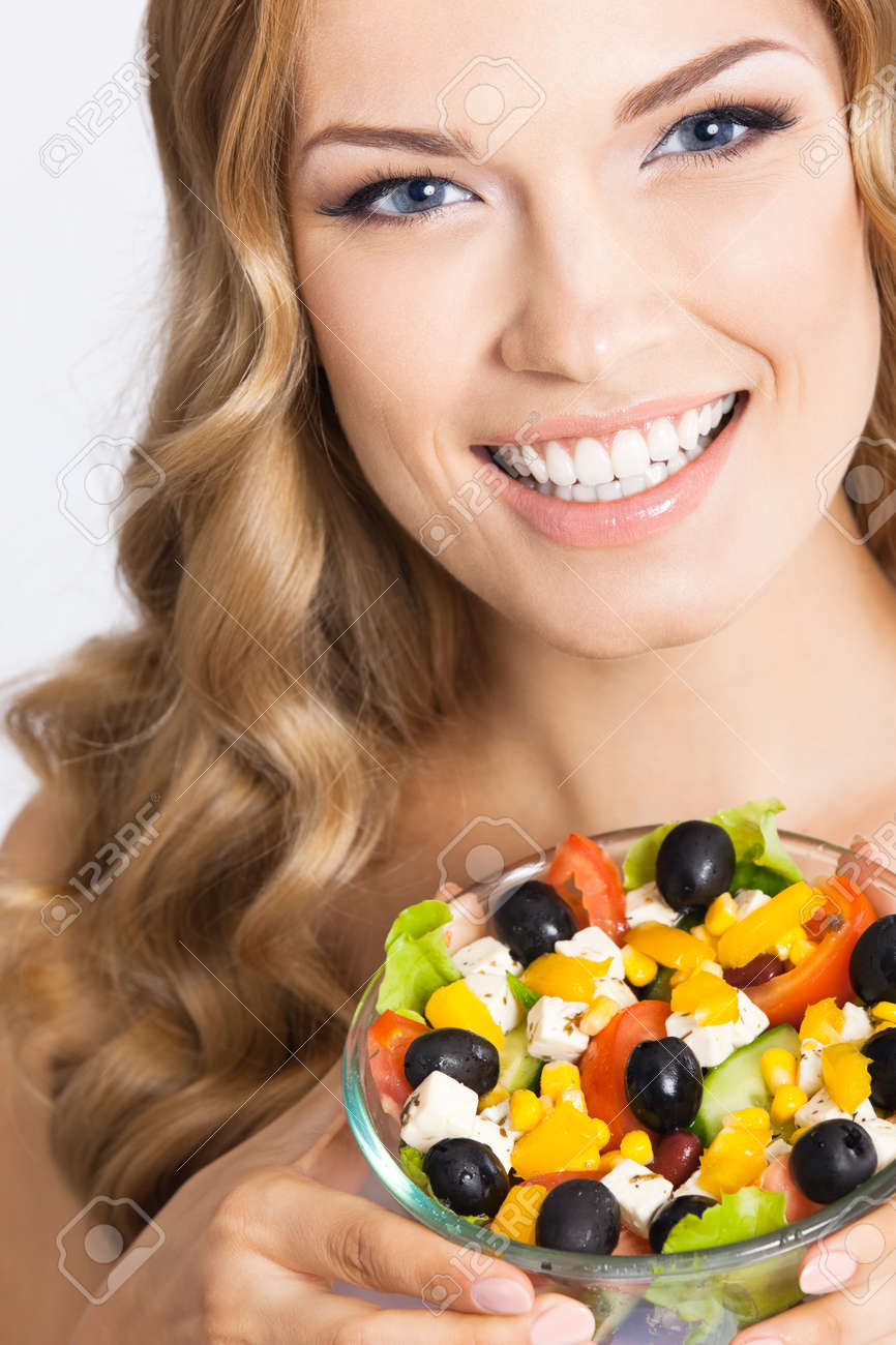 Portrait photo of happy smiling beautiful woman with healthy salad, isolated on grey background. Attractive blond girl at studio. Keto ketogenic diet concept. - 172447159