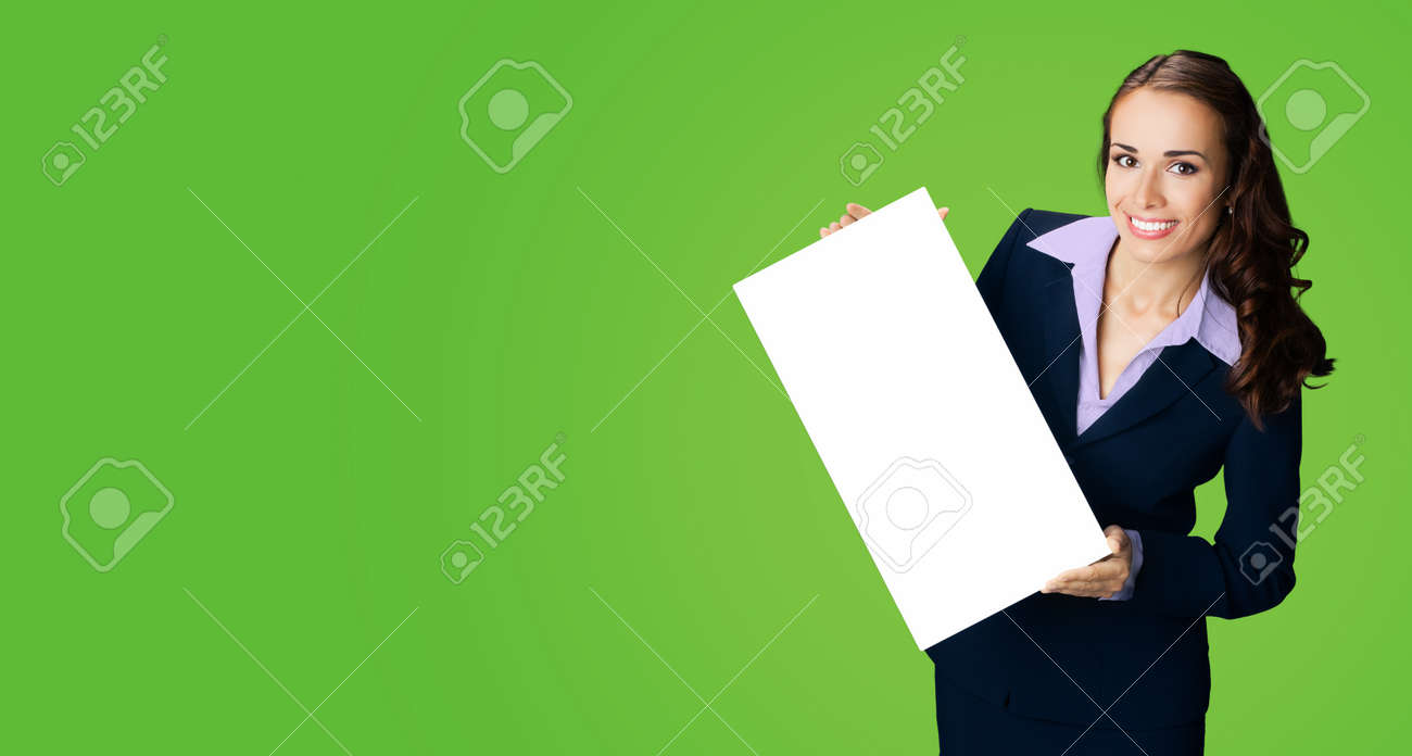 Happy smiling woman in black confident suit showing holding mock up white signboard. Business and advertising concept. Copy space empty free place for text. Green color background. - 172632145