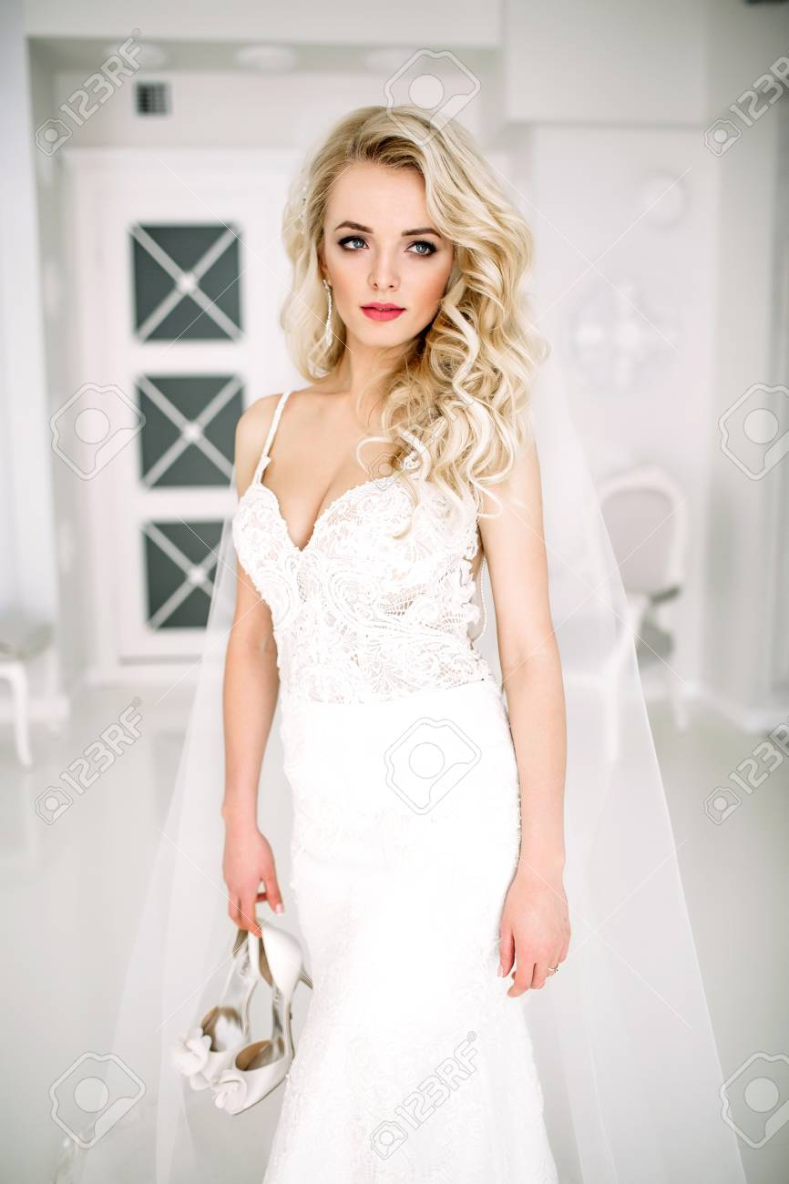 Wedding. Bride In A Beautiful Dress Indoors In A White Studio ...