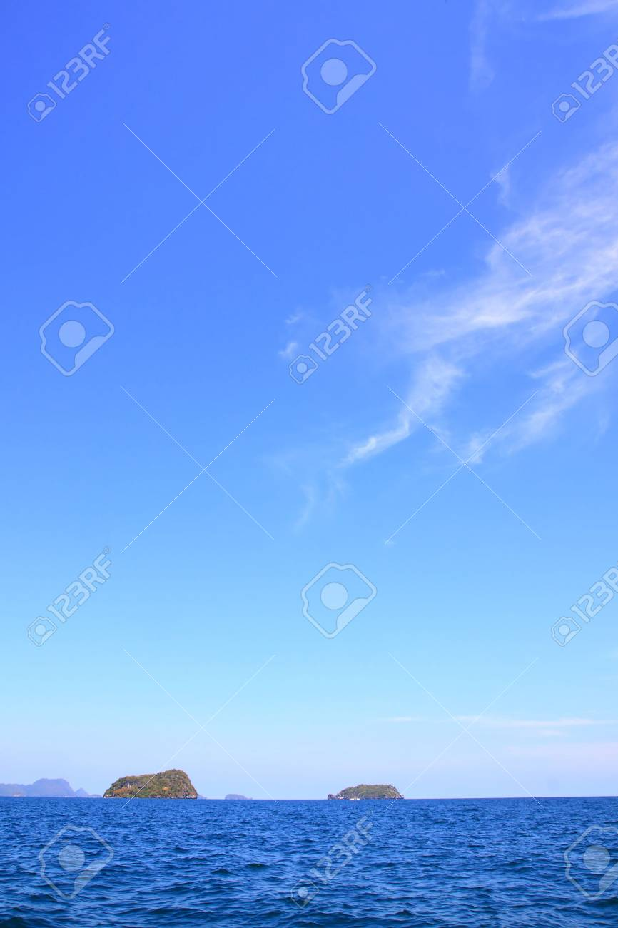 Small island with sunny and blue sky in summer Stock Photo - 7963827
