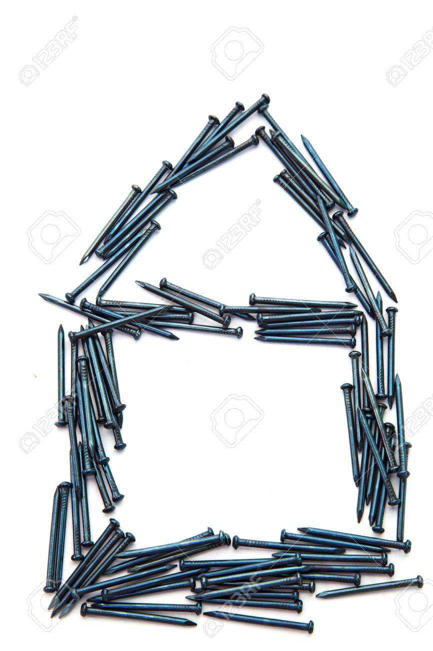Conceptual of blue steel nail construction house Stock Photo - 7963920