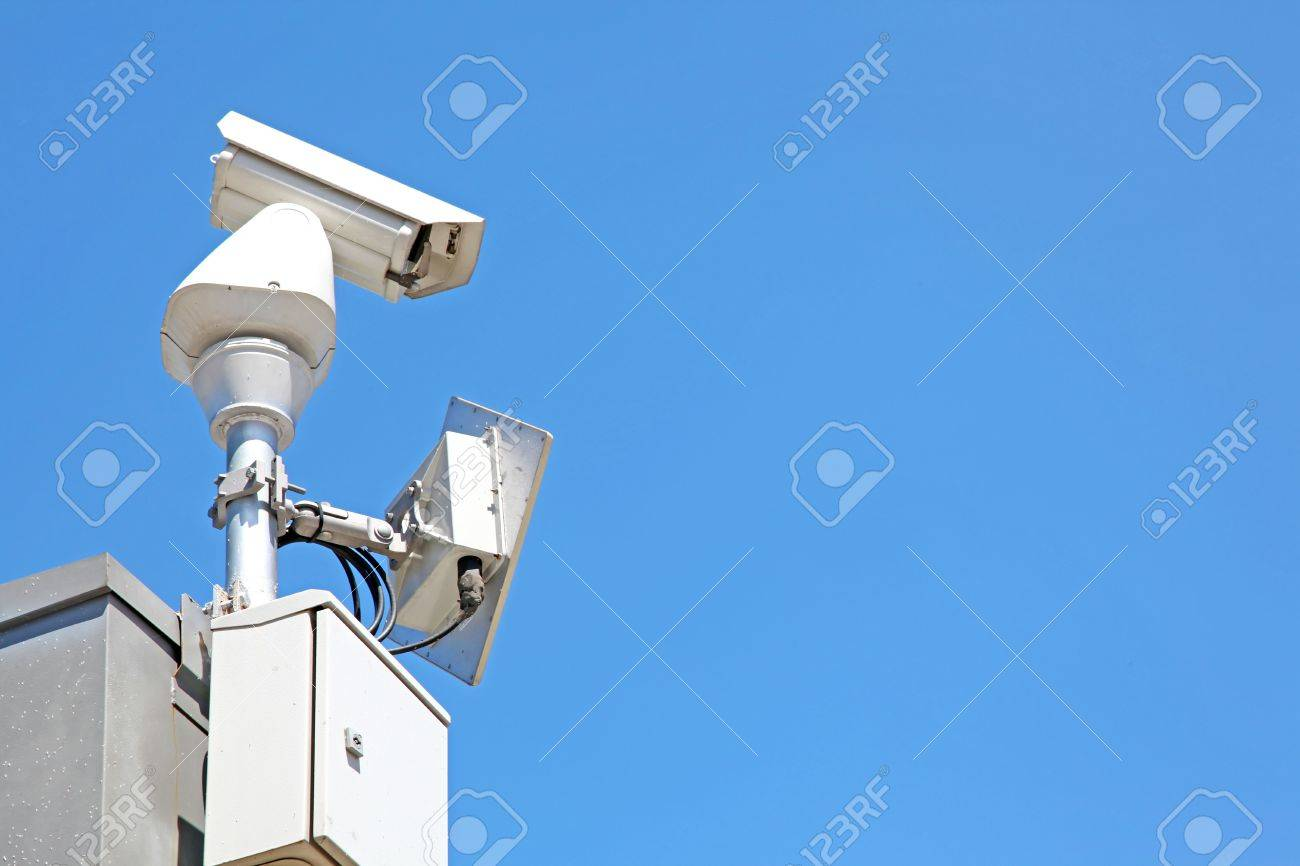 isolated Surveillance Security Camera or CCTV on blue sky Stock Photo - 8089673