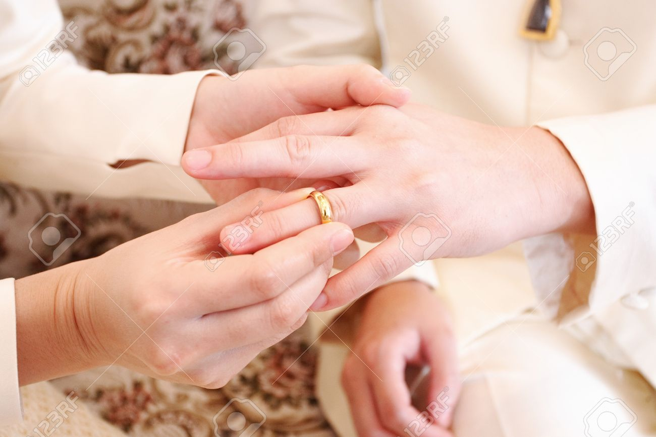 Bride Putting A Wedding Ring On Groom \'s Finger, Close Up Stock ...