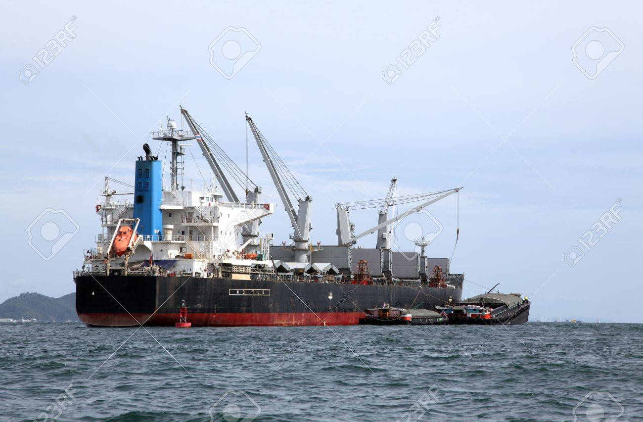 Cargo Liner Freight Ship With Containers And Tug Ship Stock Photo ...