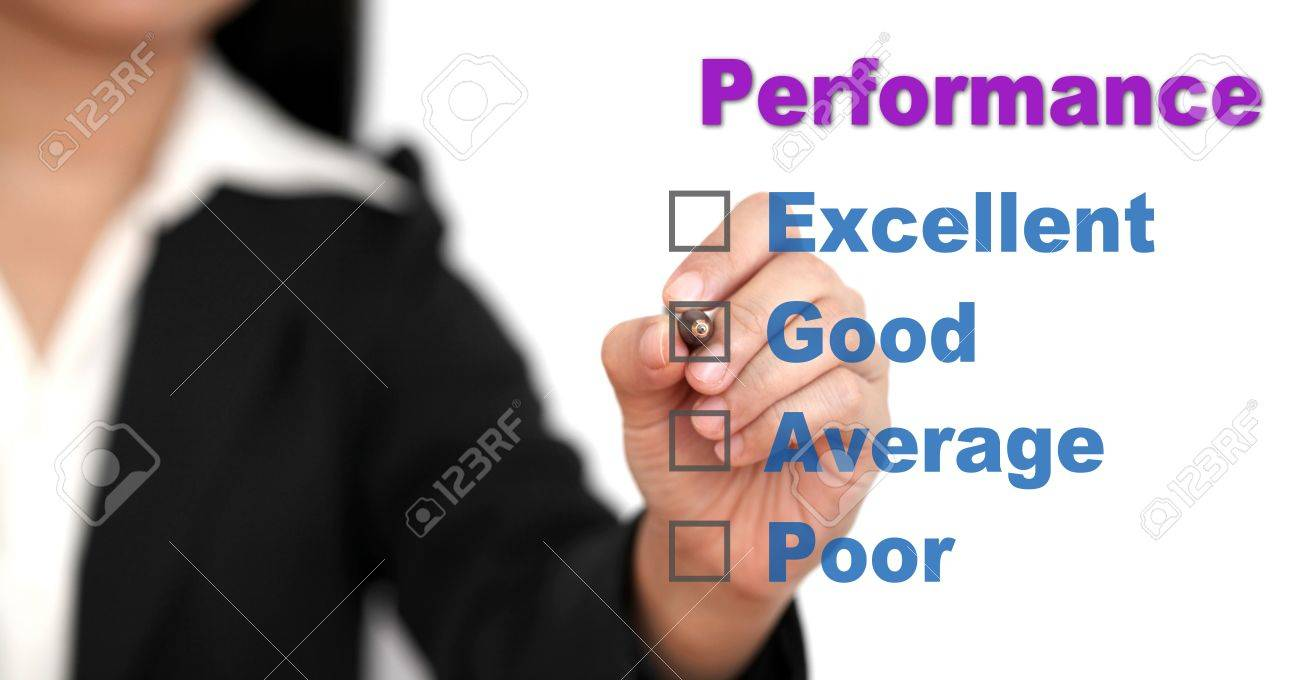 Asian business woman writing on performance audit checklist Stock Photo - 10401165