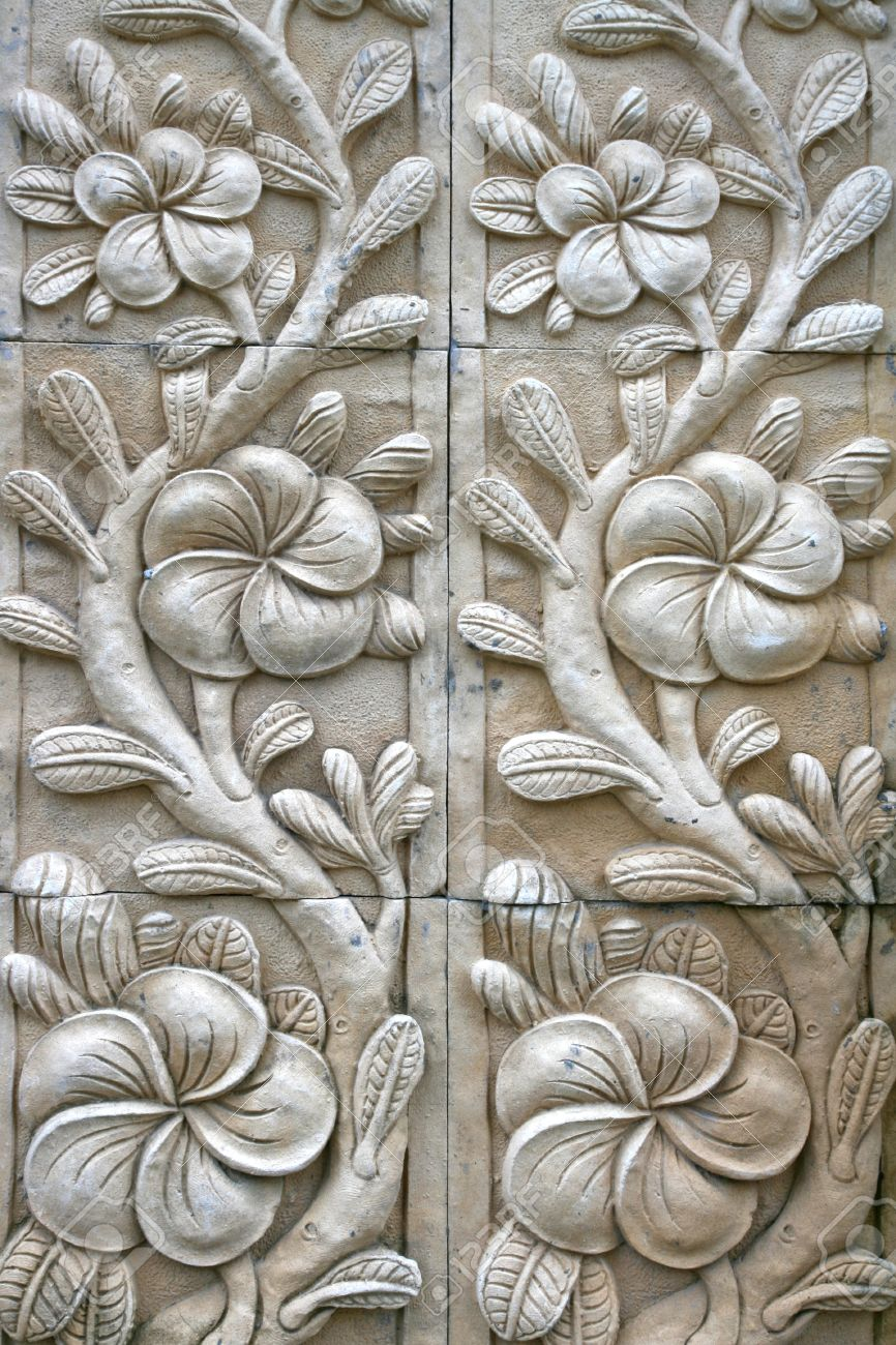 Flower shape stone carving on wall in bali style stock photo