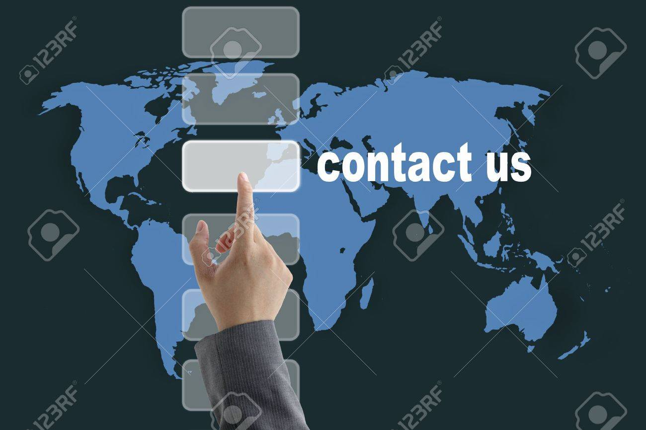 male business hand pushing on contact us button with world map background Stock Photo - 10619380