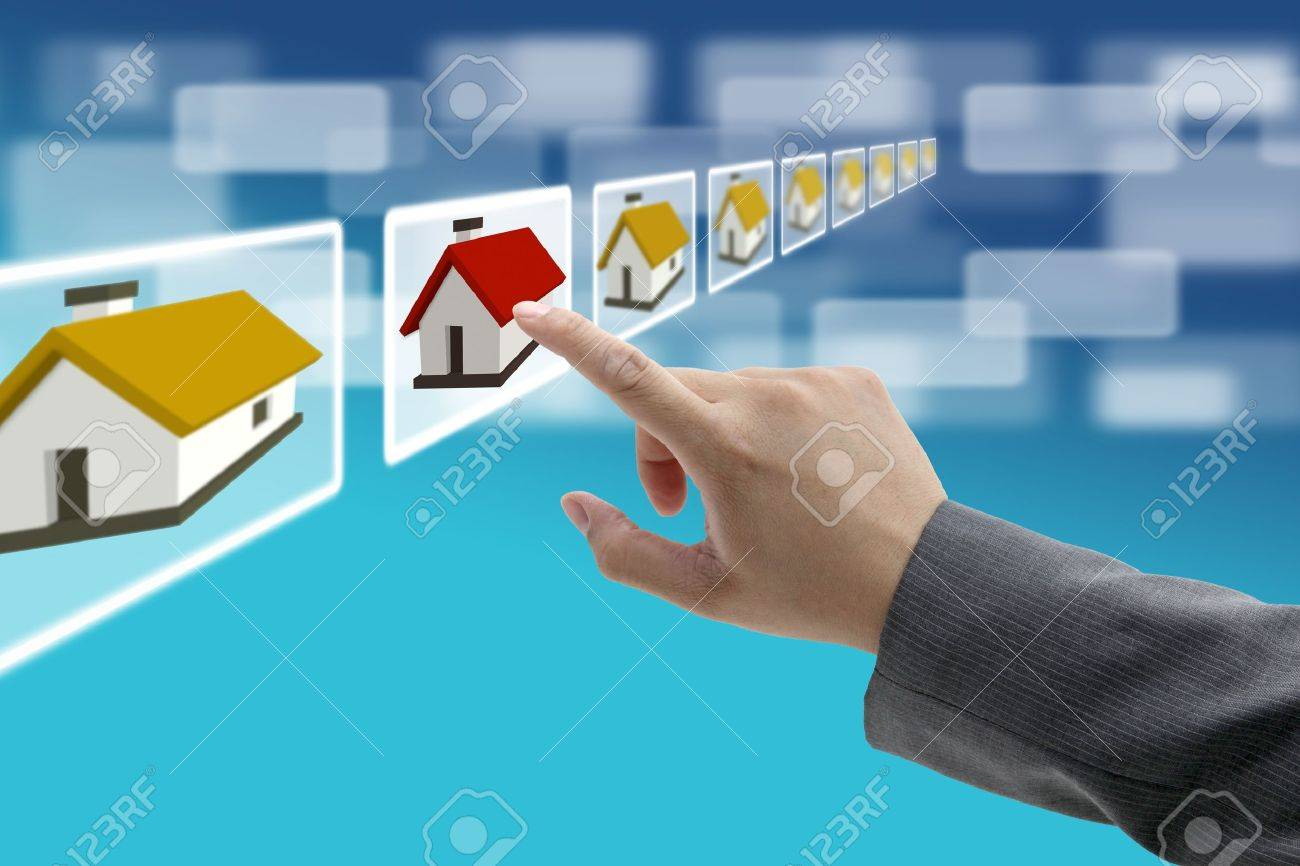 man hand Finding new property in real estate market with electronic commerce concept Stock Photo - 10743953