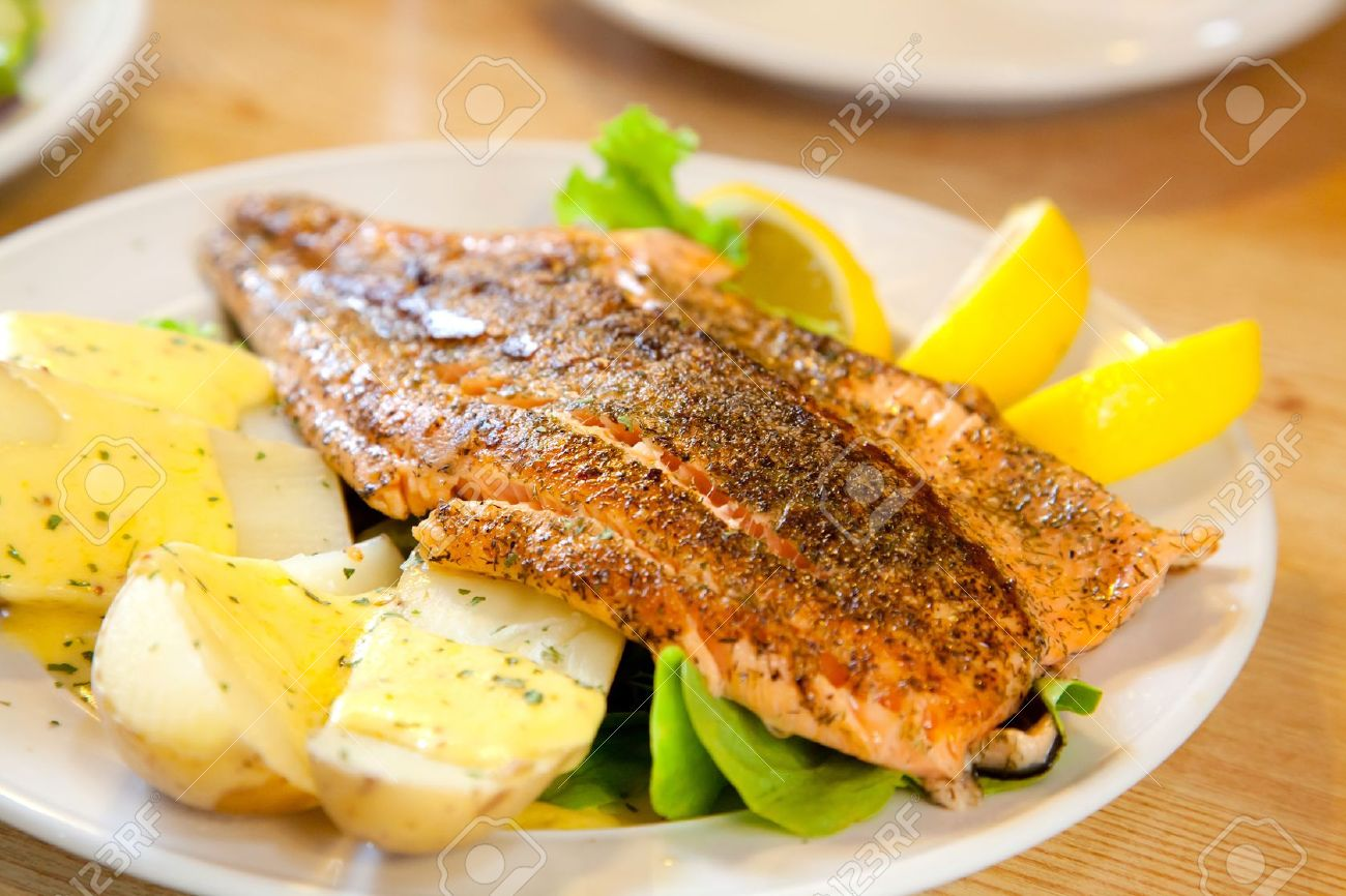 gourmet Grilled Salmon Steak with baked potato and lemon meal Stock Photo - 14773150
