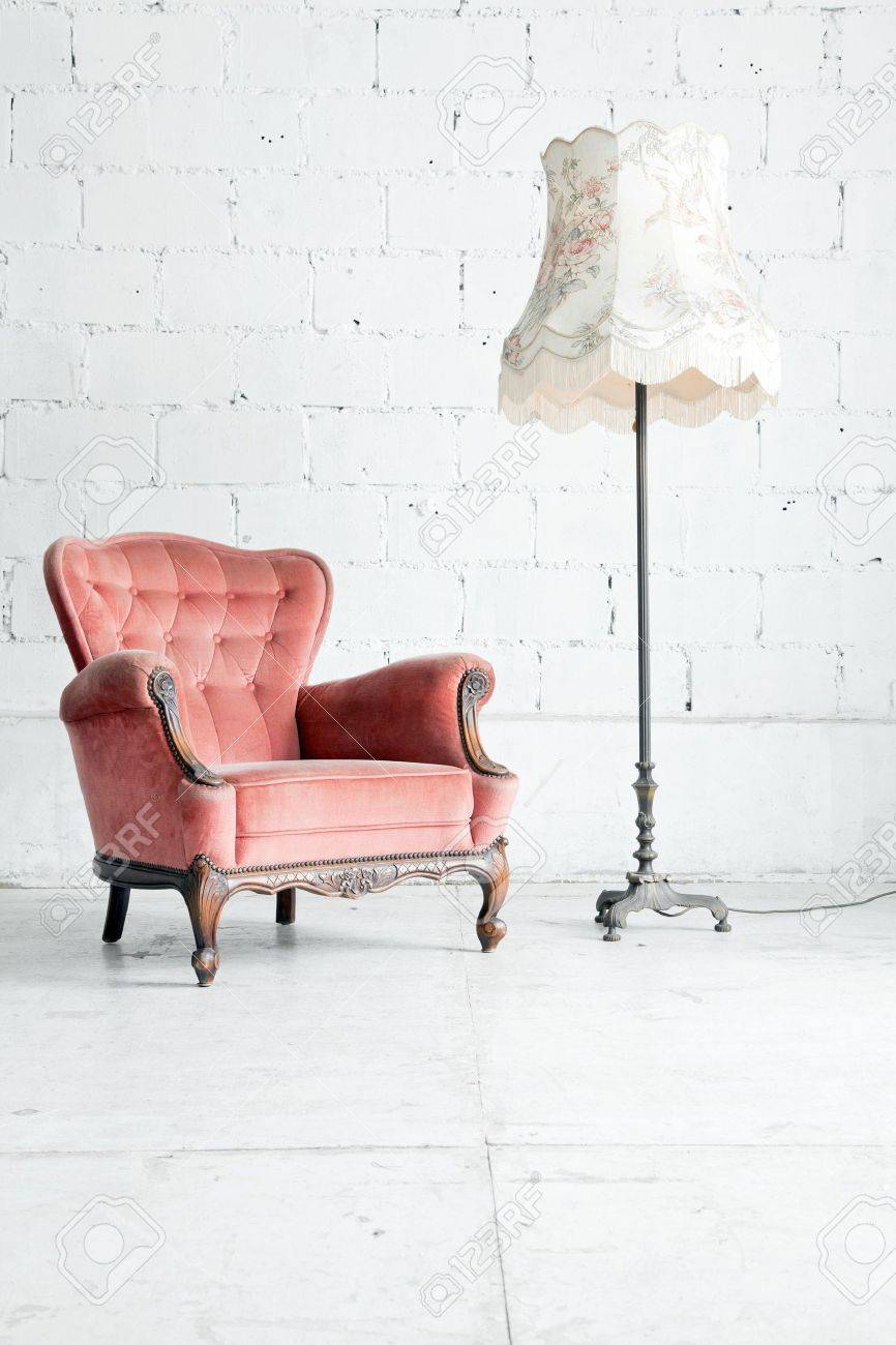 Pink classical style Armchair sofa couch in vintage room with desk lamp Stock Photo - 15727070