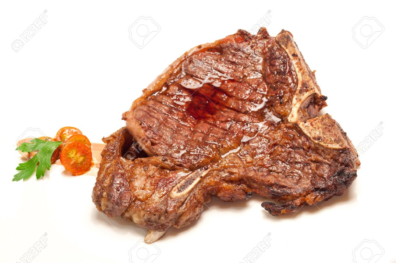 Gourmet Main Entree Course t-bone beef grilled steak on white dish Stock Photo - 16163098