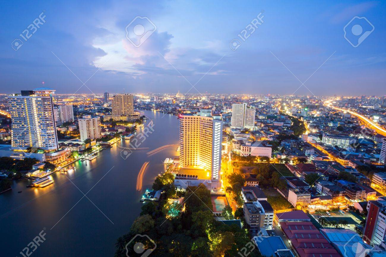 Aerial view of Bangkok Skyline along Chaophraya River at dusk Stock Photo - 17818395
