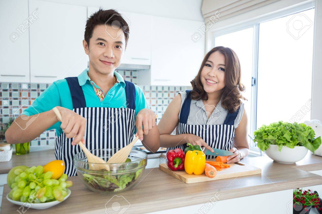 Young happy couples in domestic kitchen Stock Photo - 18733928