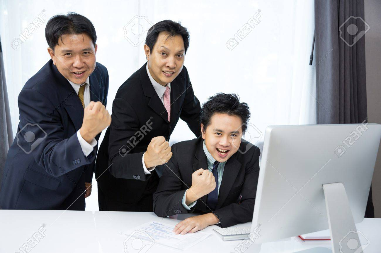 Team of businessmen analysis their business with computer desktop Stock Photo - 21361711