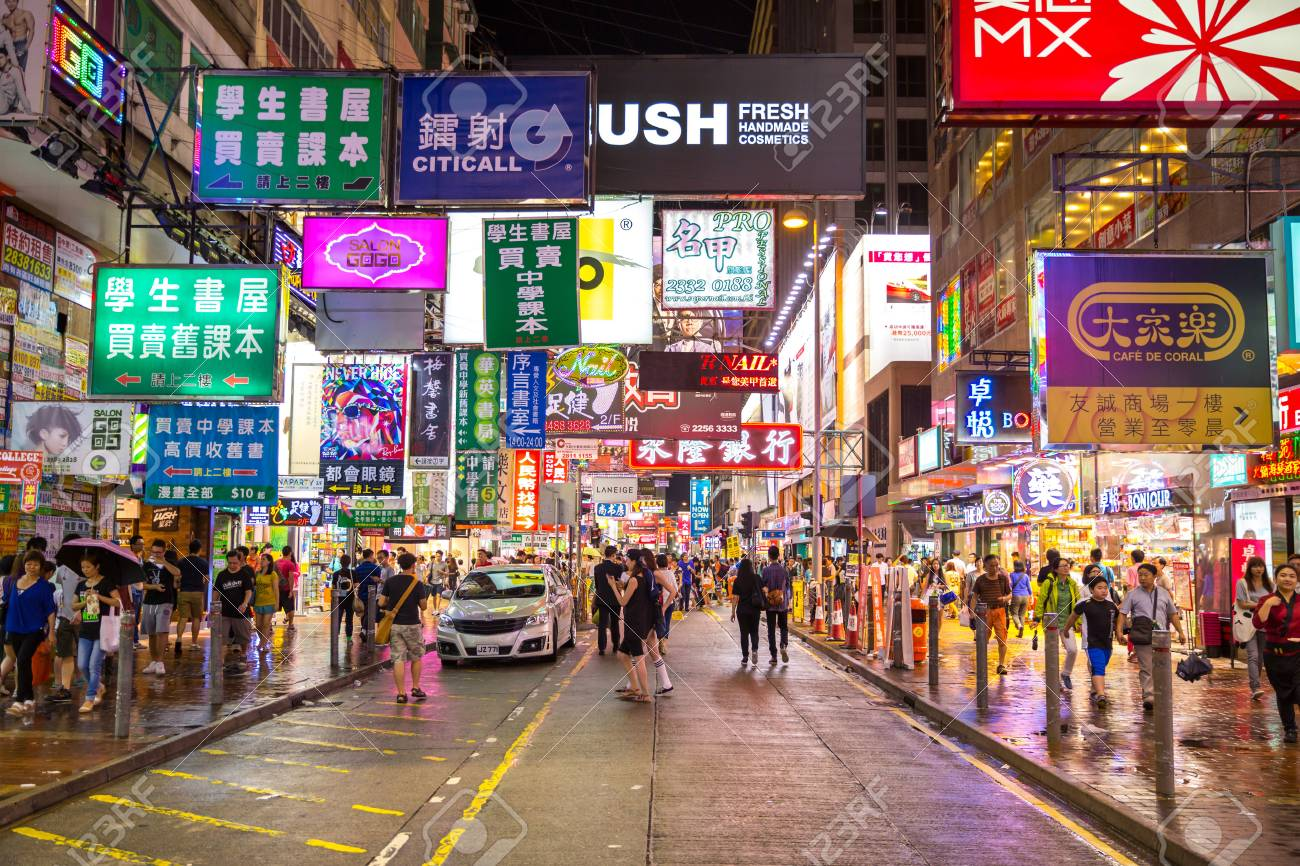 HONG KONG , CHINA - AUG 13 : Mongkok at night on August 13, 2014 in Hong Kong, China. Mongkok in Kowloon is one of the most neon-lighted place in the world and is full of ads of different companies. - 31082628