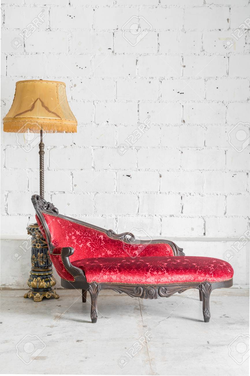 Red sofa Contemporary style in vintage room with desk lamp