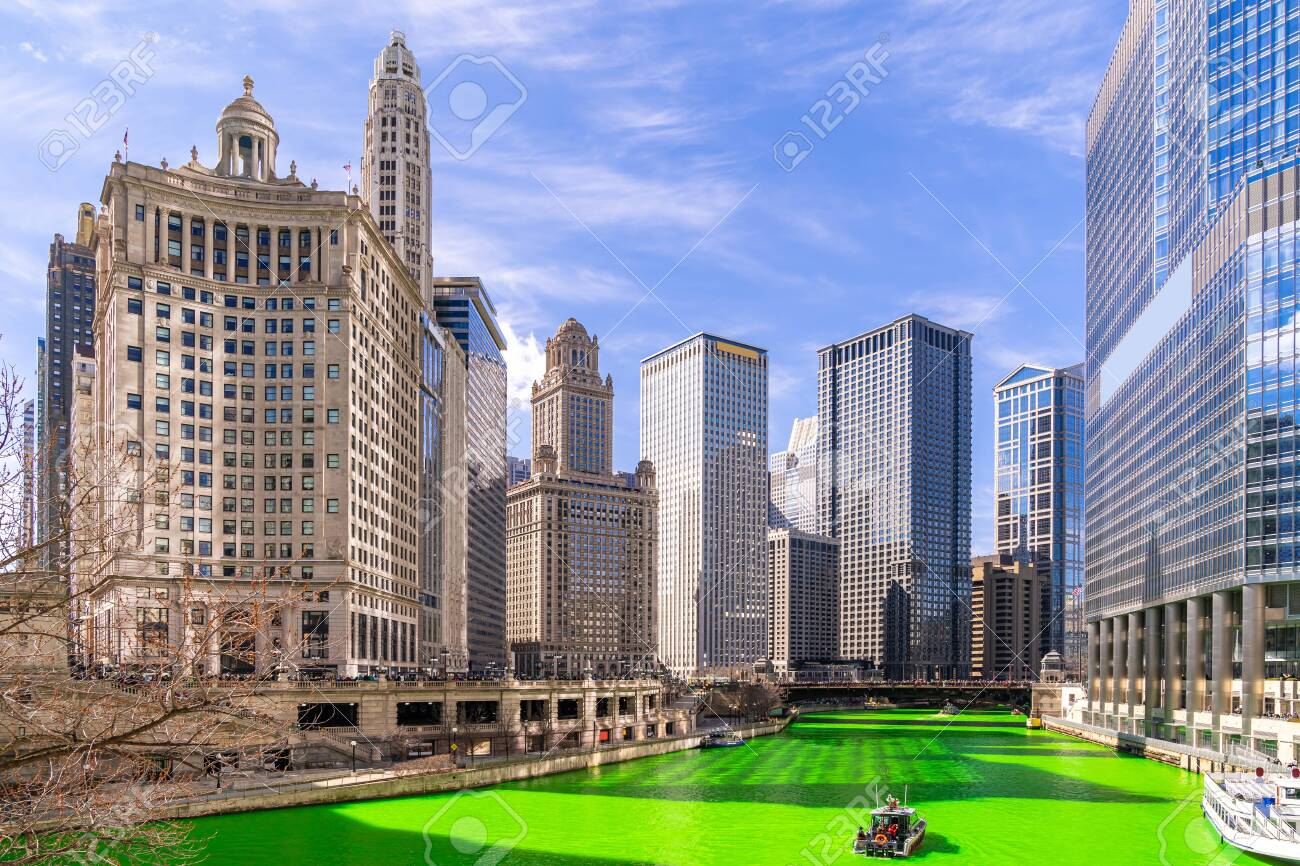 Chicago Skylines building along green dyeing river of Chicago River on St. Patrick day festival in Chicago Downtown IL USA - 128734968