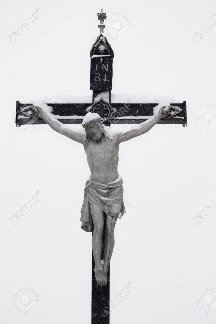 crucifixion jesus on the cross by winter snow stock photo