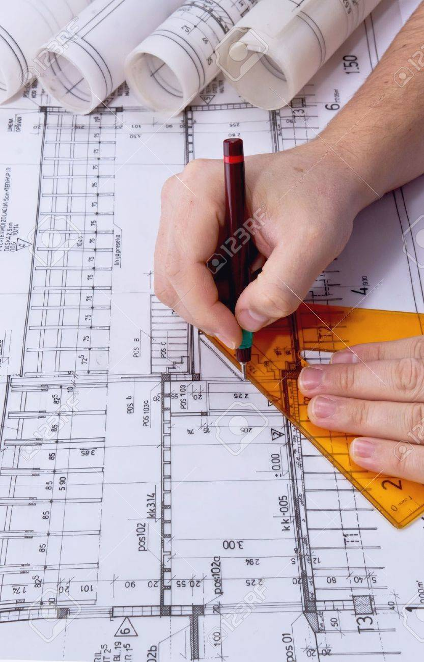 Architect drawing rolls and plans blueprints project stock photo architect drawing rolls and plans blueprints project stock photo 17843023 malvernweather Images