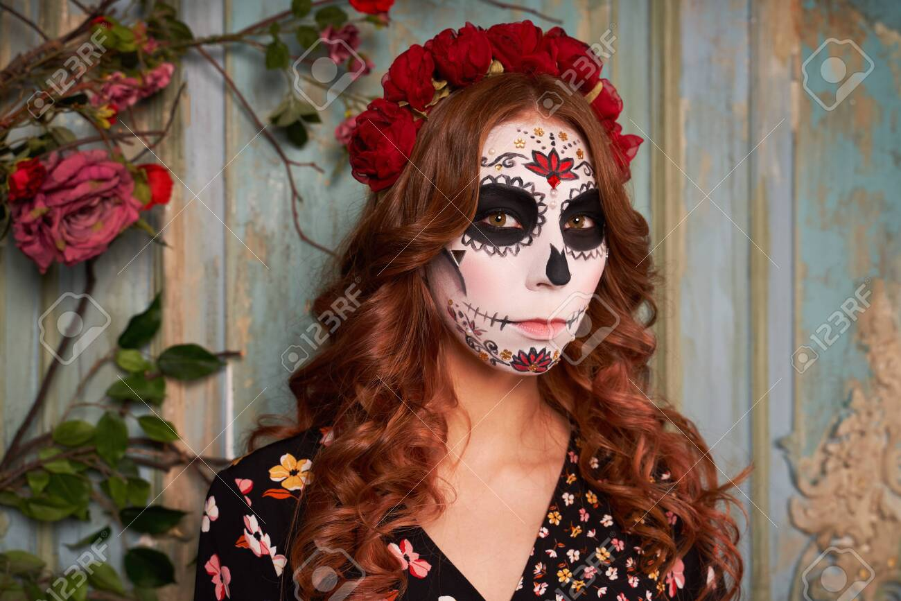 Day of dead holiday. Halloween. People in costume - 131689773